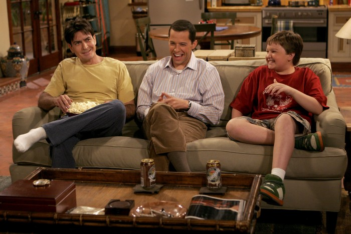"""Apologies For The Frivolities"" -- Charlie (Charlie Sheen, left) talks with his brother Alan (Jon Cryer, center) and his nephew Jake (Angus T. Jones, right) about his new girlfriend, on TWO AND A HALF MEN, scheduled to air on the CBS Television Network. Photo: Greg Gayne/Warner Bros ©2006 Warner Bros. Television. All Rights Reserved."